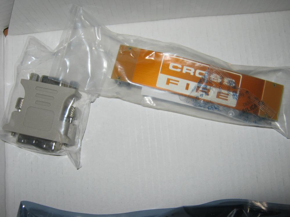 Вечные друзья - Кроссик (стединительный кабель CrossFire) и Штепсель (переходник DVI->VGA)