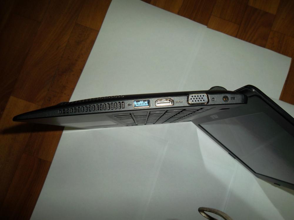 Решётка вентиляции, usb 3.0, HDMI, VGA, разъём подклчения питания.(слева на право)